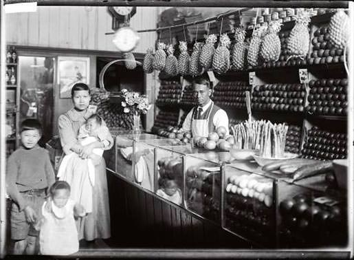 A Chinese greengrocer and his family in their shop, probably early 20th century